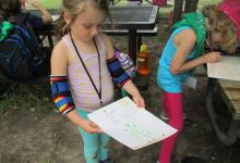 A camper and her artwork