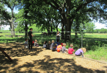 Campers listening to a story about the Kiowa tribe and the bison