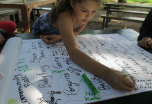 A camper helping to make a memory map