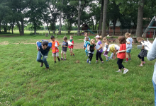 Campers embodying animals at the Koan School