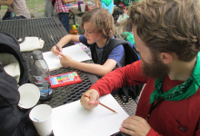 A camper and his camp leader sketching
